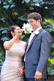 Groom smelling Bridal Bouquet
